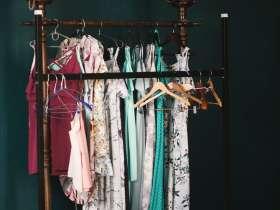 dresses hanging on a standing rack closet analysis