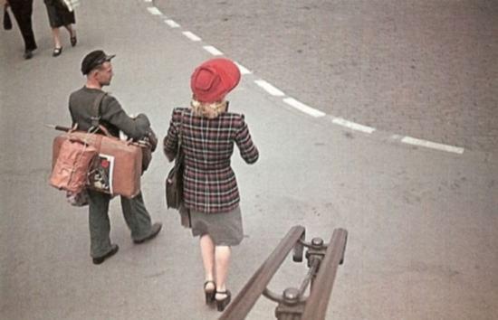 A back view of a white woman on a Paris street