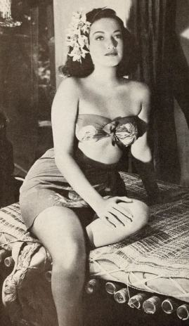 Black and white still of Dorothy Lamour in a bandeau top and sarong