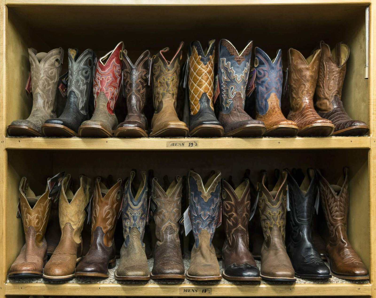 Two racks of cowboy boots