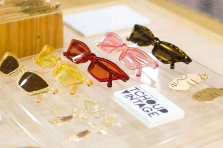 a row of multicolored vintage sunglasses from ladypreneur Lesly Washington tchoup vintage