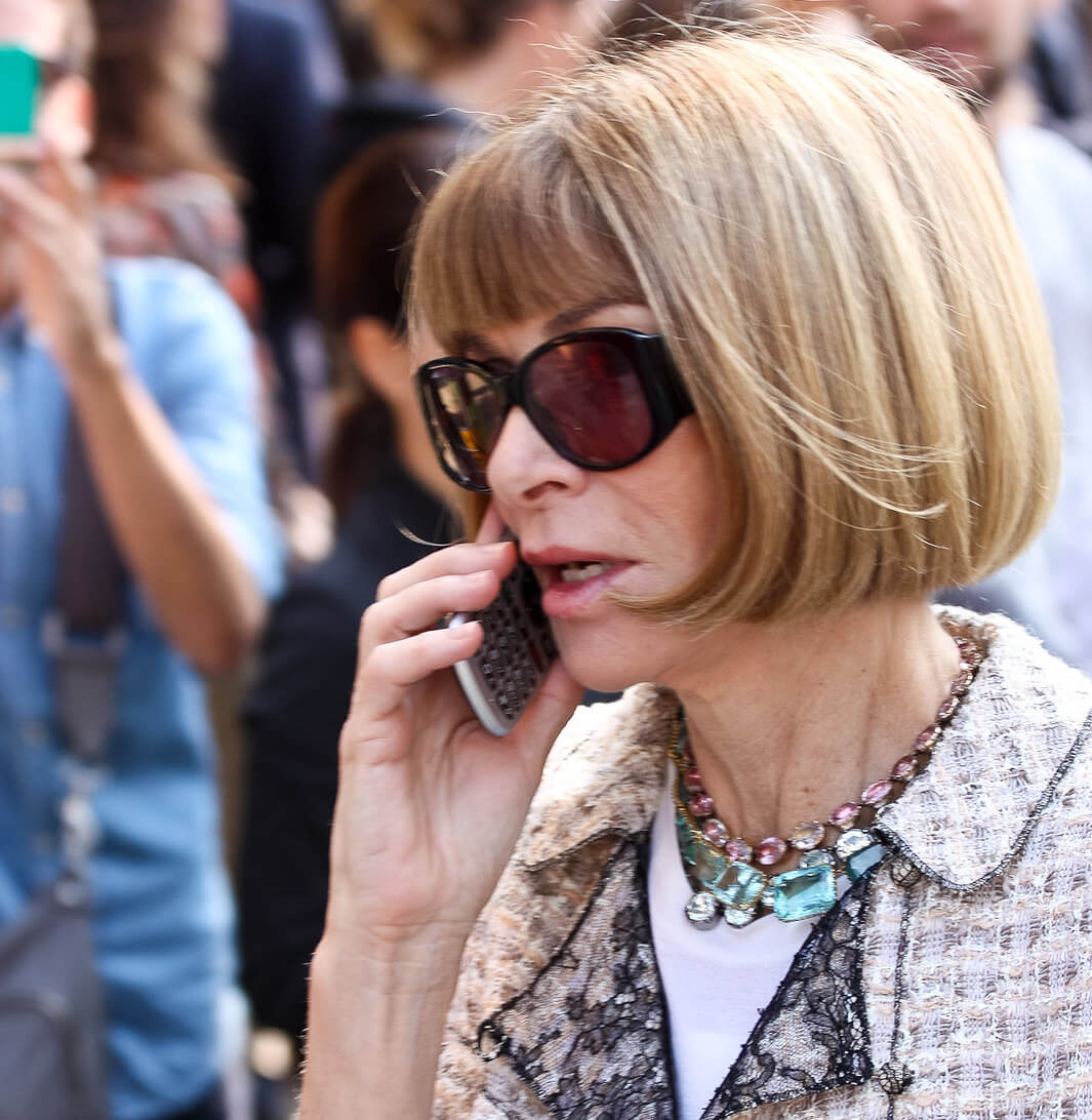 Close up of Anna Wintour talking on a phone