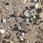 An old bottlecap on a rocky ground. pictures help manage OCD