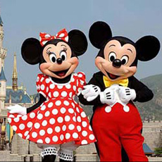 Mickey Mouse and Minnie Mouse in front of the Sleeping Beauty Castle