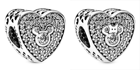 both heart shaped charms feature mickey on one side and minnie on the other and are trimmed by a heart filigree around the edge available wherever pandora