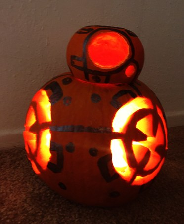 9. Place candle inside of bottom pumpkin and light BB-8 up!