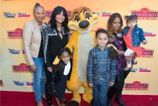 Christina Milian and family attend the