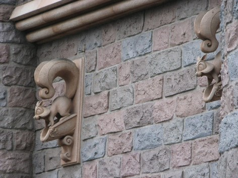 Squirrel drain spouts along the sides of the Sleeping Beauty Castle (Photo via Phactual)