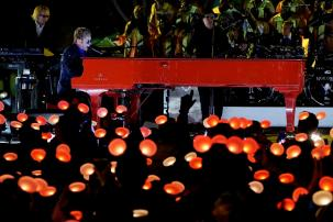 """Elton John performs on his million dollar red piano in front of Disneyland's Sleeping Beauty Castle for the ABC Television Special, """"The Wonderful World of Disney: Disneyland 60"""" that will air February 21st at 8 p.m. (c) OC Register"""