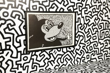 NEW YORK, NY - NOVEMBER 06: Art by Kieth Haring. Mickey: The True Original Exhibition celebrates 90 years of Mickey Mouse's influence on art and pop culture. Opening November 8, 2018 through February 10, 2019, this immersive experience is inspired by Mickey's status as a 'true original' and his consistent impact on the arts and creativity in all its forms. Guests will have the chance to explore the 16,000 square-foot exhibition featuring both historic and contemporary work from renowned artists. The exclusive pop-up retail shop carries special merchandise and offers customization. (Photo by Craig Barritt/Getty Images for Disney)