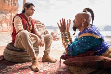 Mena Massoud as the street rat with a heart of gold, Aladdin, and Will Smith as the larger-than-life Genie in Disney's ALADDIN, directed by Guy Ritchie.