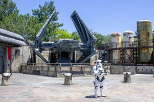 A lone Stormtrooper guards a First Order ship on the planet Batuu at Black Spire Outpost. Photo by Mark Eades.