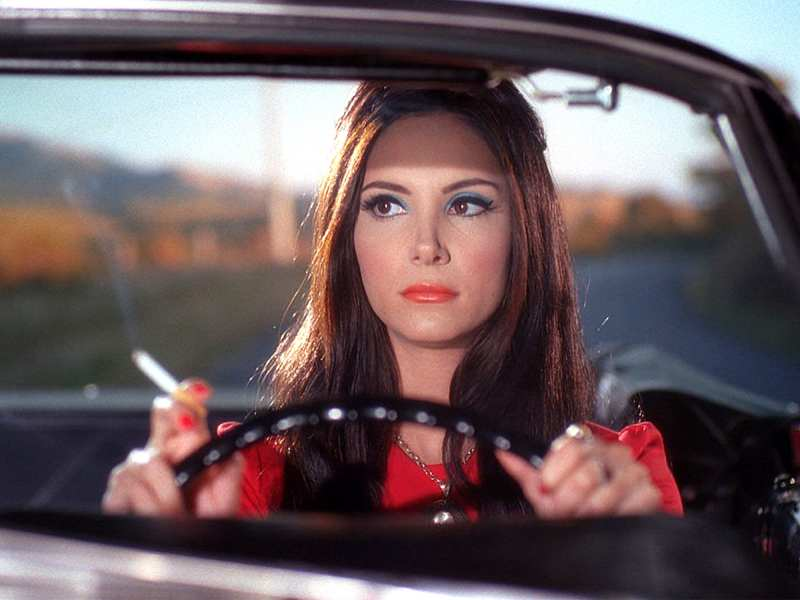 elaine drives while smoking a cigarette