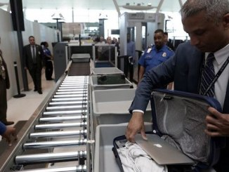 airline security laptops