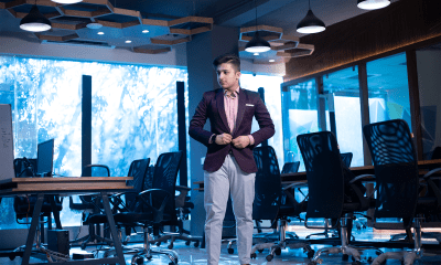 Lakshay Jain standing his workspace of Mevrex