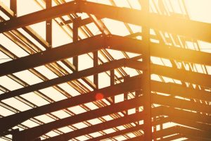 Black steel frame roof with sunlight shining through