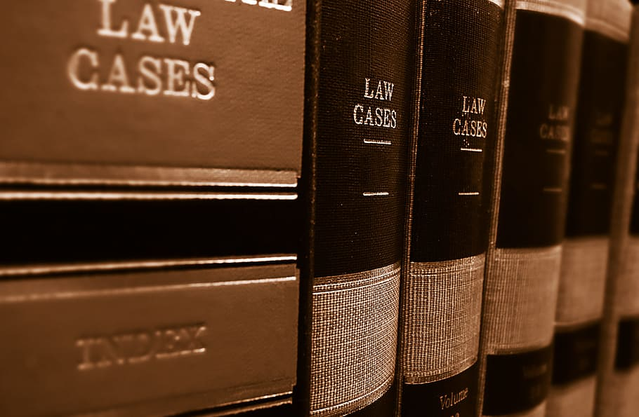 leather bound books on a shelf that say law cases on the spine
