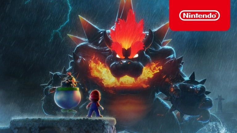 A still from Super Mario 3D World + Bowser's Fury where Mario and Bowser Jr. are looking at an enormous Bowser who is dark grey and red with fire in his mouth