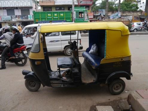 Empty black autorickshaw