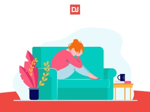 a remote employee affected by motivation killers at remote work sits on couch