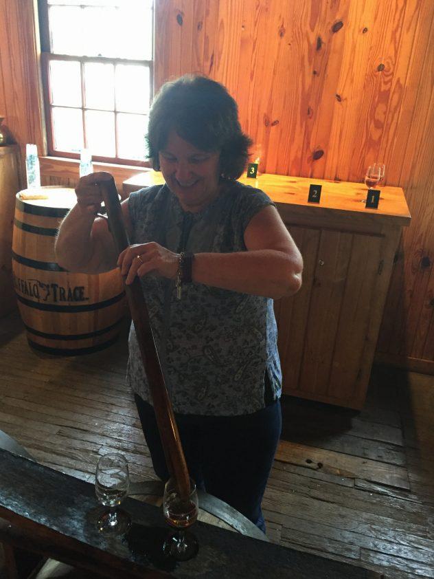 Bev Taylor of Cork & Barrel drawing a bourbon sample