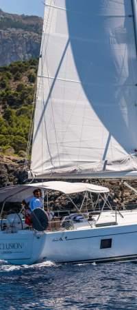 Yacht passing Mallorcan landscape