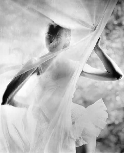 Dancing model behind veil, New York, 1946