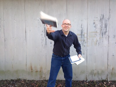 Matt tossing book forward