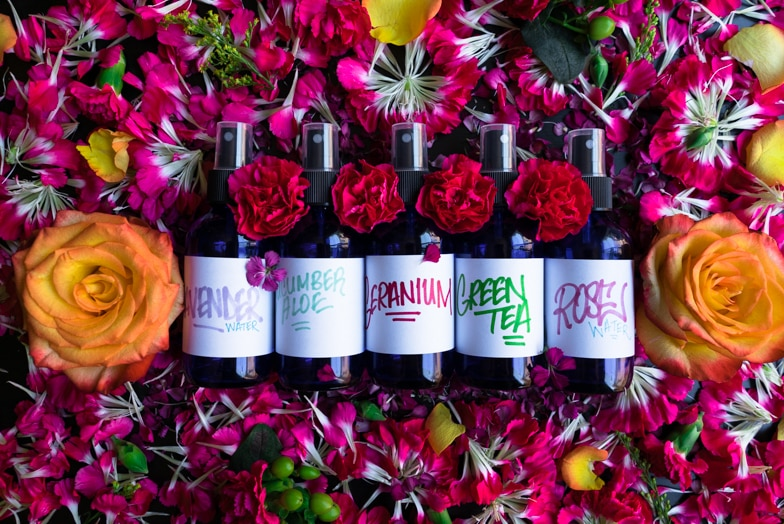 5 DIY facial mists for glowing skin surrounded by flower petals and roses.