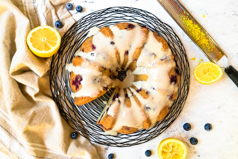 Blueberry muffin cake drizzle with lemon glaze.