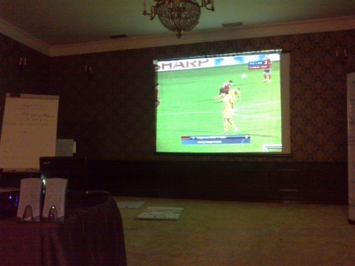Watching Armenia - Macedonia match on an LCD projector screen in Tbilisi