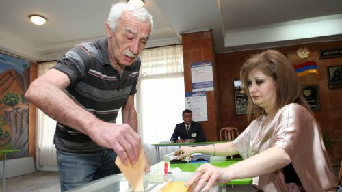 Armenia - A man is casting his ballot in the parliamentary elections in Armenia, Yerevan, 06May2012 | Photolure