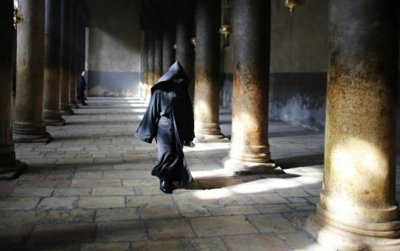 Palestine -- An Armenian Orthodox priest walks inside the Church of the Nativity after a Christmas procession in the West Bank town of Bethlehem, 18Jan2013