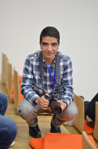 Armenia -- A photographer never has photos, so I decided to take a photo of this photographer at Barcamp Vanadzor, 06Nov2016
