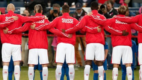 2014-05-30 20:44:36 epa04232829 Switzerland's players listen to the national anthem prior to the international friendly soccer match between Switzerland and Jamaica at the Swissporarena in Lucerne, Switzerland, 30 May 2014. The Swiss team is preparing for the upcoming FIFA World Cup 2014 in Brazil which starts on 12 June. EPA/PETER KLAUNZER