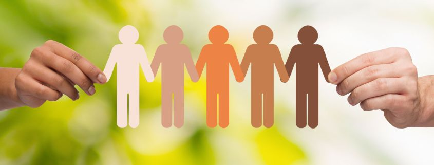 36289344 - community, unity, people and support concept - couple hands holding paper chain multiracial people over green background