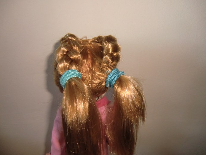 Two ponies/pigtails.
