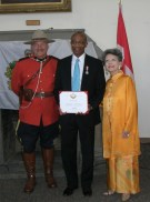 Hamlin Grange awarded Queen's Jubilee Medal by Senator Vivienne Poy