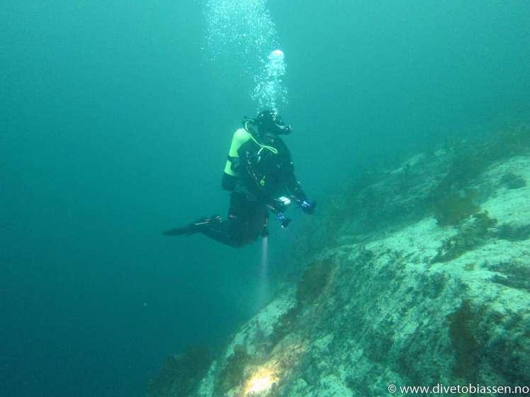 Toppen av bergvegg, dykker, PADI Videregående dykkerkurs/AOW, Oppfriskningskurs