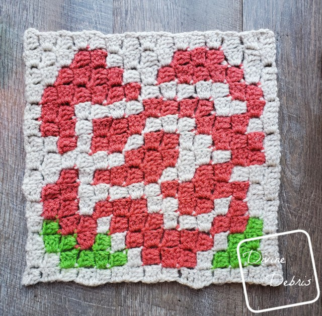 [image description] Rose Afghan Square laying flat