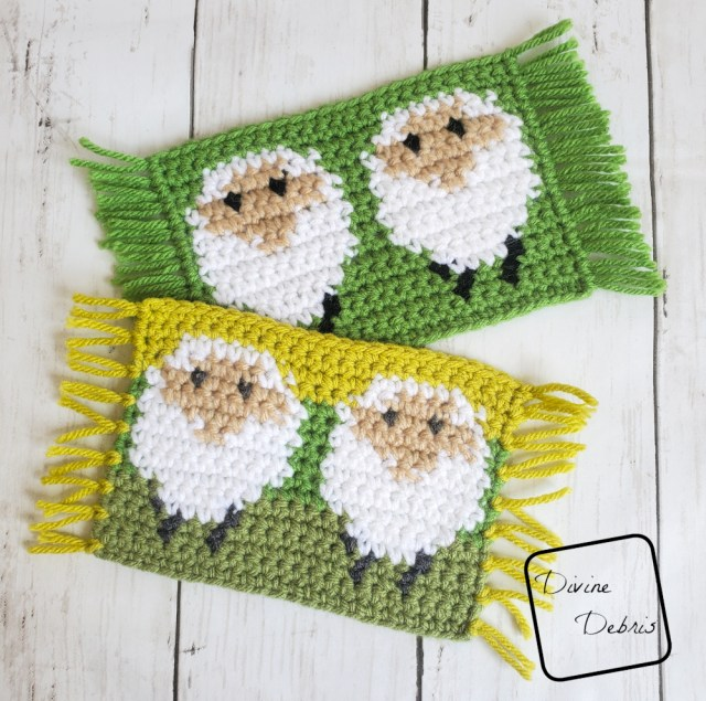 [image description] Two of the sheep mug rugs, rectangular coasters of a white sheep on a green background lay on top of each other. The Dancing Sheep Mug Rug