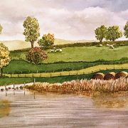 watercolor of lake with haybales and sheep in Ireland