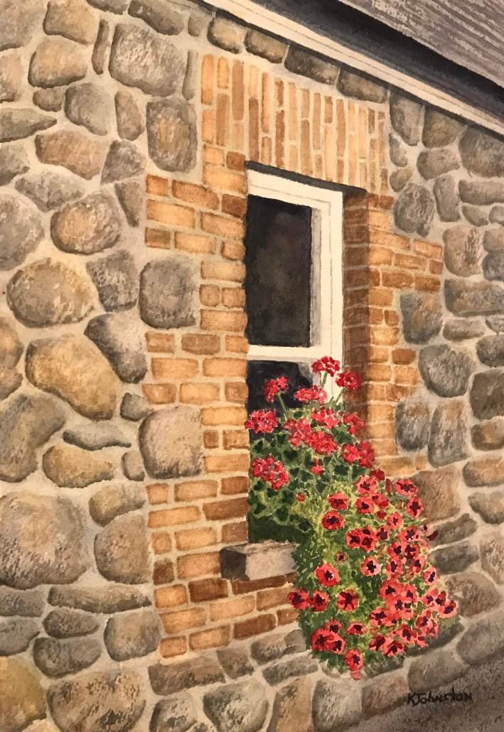watercolor of stone and brick Irish home with red flowers