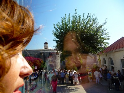 Divine Light Vibrations, Glenn Younger author and spiritual coach, bus reflection in Dubrovnik, Croatia.