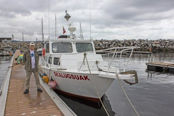 Jeffrey Gallant and GEERG's research vessel, the Skalugsuak, in Baie-Comeau, Québec. Photo © GEERG.ca