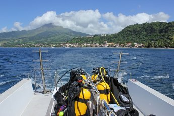 Mount Pelée volcano and the town of Saint-Pierre seen from the dive boat. Photo © Jeffrey Gallant | Diving Almanac