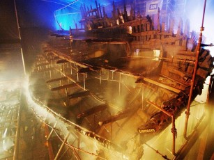 The Mary Rose undergoing conservation with polyethylene glycol at the Historic Dockyard in Portsmouth. Photo by Mary Rose Trust (CC BY-SA 3.0)
