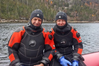 David Doubilet and Jennifer Hayes looking for Greenland sharks in the St. Lawrence Estuary. Photo © Jeffrey Gallant   Diving Almanac