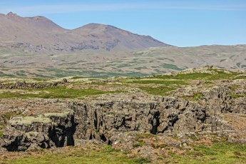 The fissure at Þingvellir marks the crest of the Mid-Atlantic Ridge, or the continental divide between the European and North American continents. Photo © Jeffrey Gallant