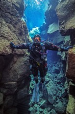On Teddy's left, the North American tectonic plate. On his right, the Eurasian tectonic plate. Photo © Jeffrey Gallant | Diving Almanac